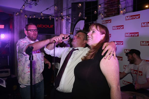 Jon Ashworth and Angela Rayner singing at the Daily Mirror Labour Conference party 2017